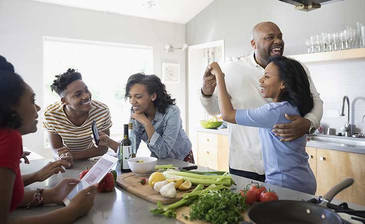 african american parents dancing and cooking