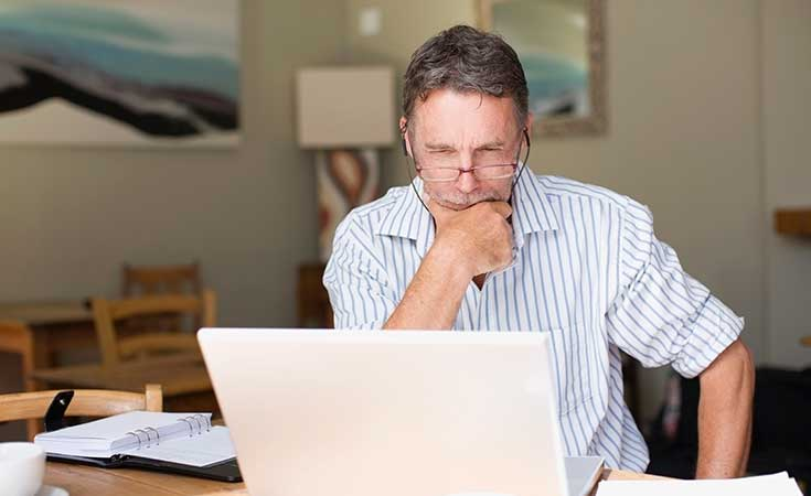 man sitting working at laptop