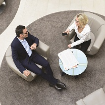 overhead image of man and woman having a meeting