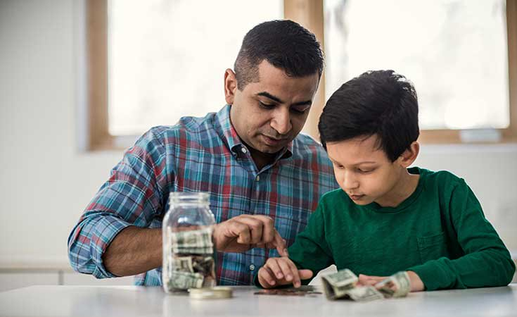 father helping son count money