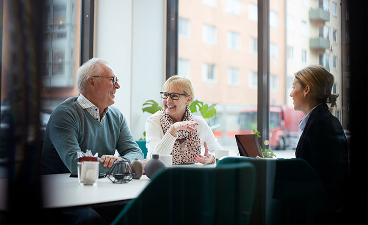 older couple sitting at a table with an advisor