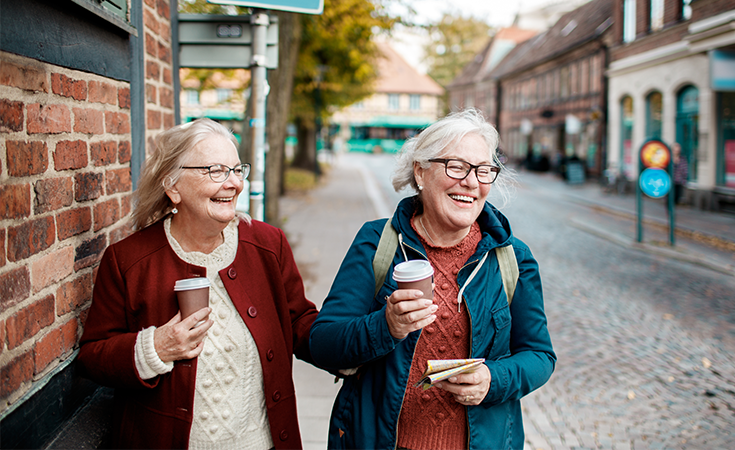 two older woman walking down the street