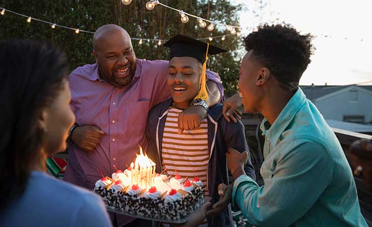 African American family celebrating teen son's birthday