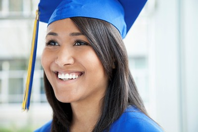 Girl in blue cap and gown
